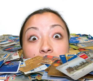 woman drowning in credit cards