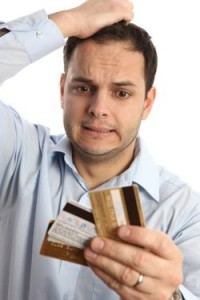 man holding credit cards